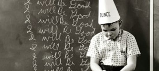 Child in dunce cap