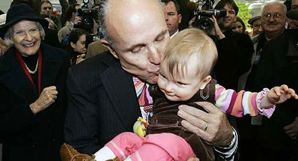Politician kissing a baby